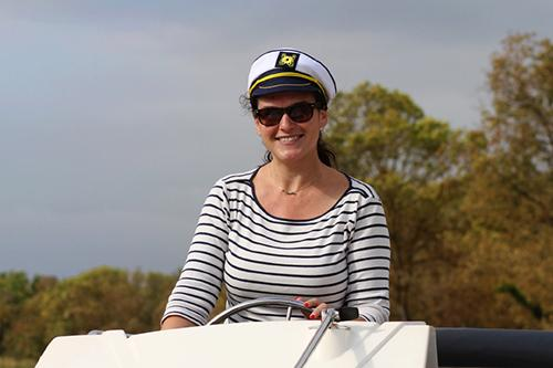 Woman Boat Captain on a Le Boat houseboat cruiser rental