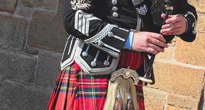 Bagpipe player in a kilt