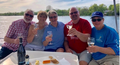Friends drinking wine on the Le Boat in Canada